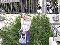 Titty-flashing blonde teen Christine Young teasing outdoors
